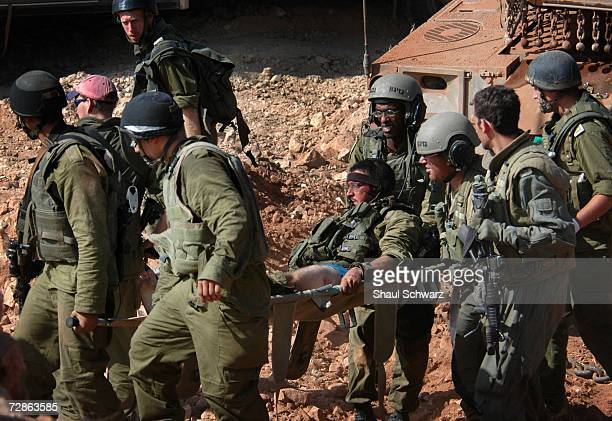 A wounded Israeli soldier is evacuated after he was injured during action against Hezbollah guerillas in south Lebanon near the border village of...