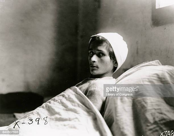 A wounded Italian soldier lies confined to a hospital bed with tuberculosis 1919