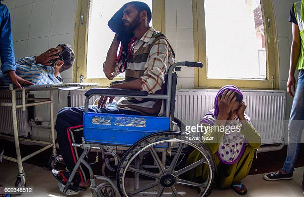 Wounded Kashmir Muslims wait in a hospital room to receive treatment form doctors after Indian government forces fired bullets and pellets at them in...