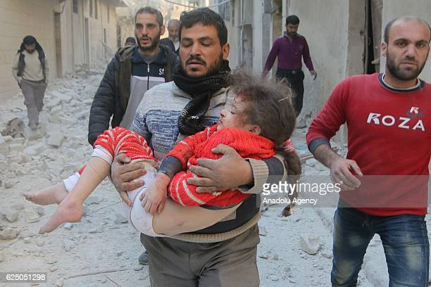 A wounded kid is taken to the hospital after the war crafts belonging to the Syrian Army carried out airstrike over residential areas at Muyesir...