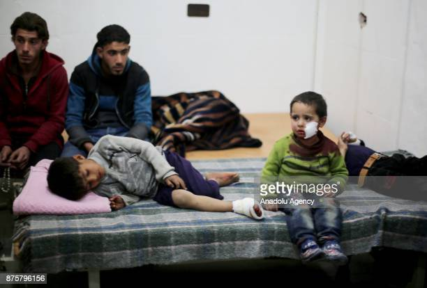 Wounded kids are seen as they wait to receive medical treatment after Assad regime's war crafts carry out intensifying cluster bombs over residential...