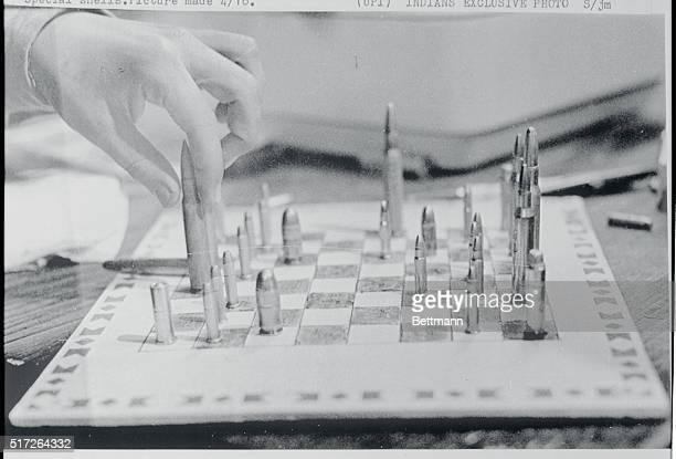 Wounded Knee South Dakota Members of AIM American Indian Movement who currently hold this hamlet spend time playing on a makeshift chess set made up...