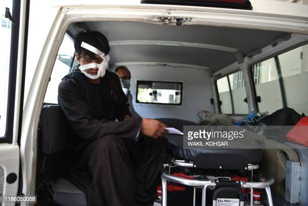 A wounded man is brought by ambulance to the Wazir Akbar Khan hospital following a suicide attack in Kabul on September 5 2019 The Taliban killed at...