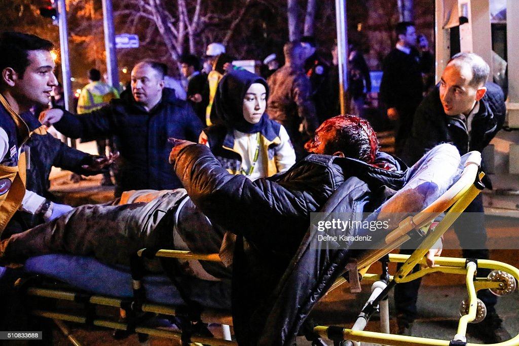 A wounded man is carried to an ambulance after an explosion on February 17, 2016 in Ankara, Turkey. 21 people are believed to have been killed and at least 61 are said to be wounded according to the city's governor Mehmet Kiliclar in what appeared to have been a car bomb attack on a vehicle carrying military personnel in the Turkish capital.