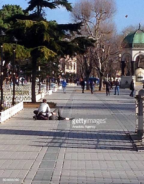 A wounded man is seen on the ground at the Sultanahmet tourist district after an explosion in Istanbul Turkey on January 12 2016 Turkish police have...