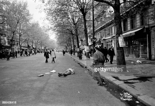 A wounded man lies in a street of the Quartier Latin during a student protest in Paris in May 1968 during the May 1968 events in France / AFP PHOTO /