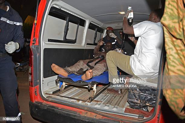 A wounded man receives medical care outside the Splendid hotel during an attack on both the hotel and a restaurant by AlQaeda linked gunmen late on...