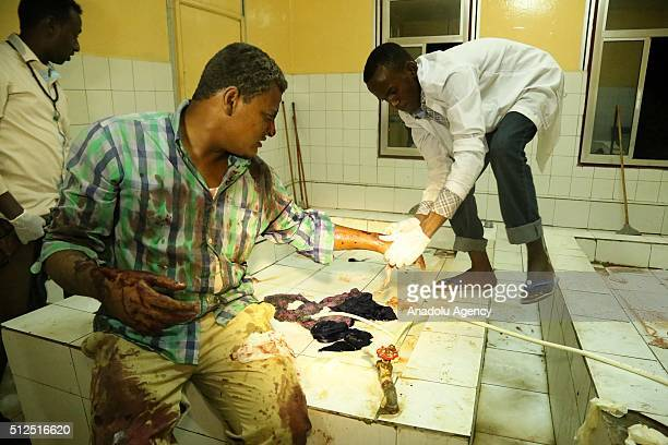 A wounded man receives treatment at a hospital after Somalias alQaeda linked Alshabaab fighters have detonated a car bomb outside a hotel in the...