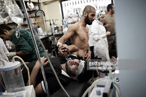 A wounded member of the Free Syrian receives medical treatment inside Dar Al Shifa hospital in Aleppo Syria October 1 2012