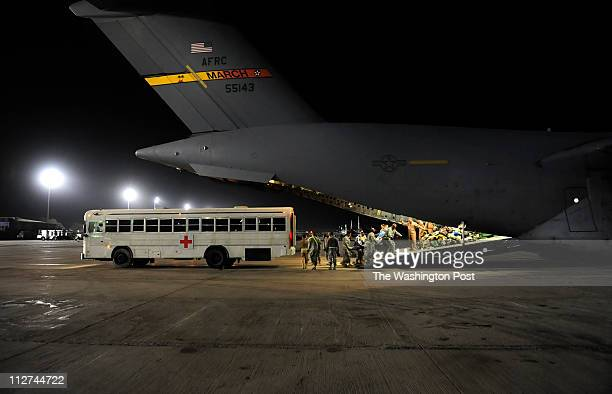 Wounded NATO soldiers are taken by bus, then loaded onto a C-17 Aero medical flight to Germany after a short stay at the hospital at Bagram air base...
