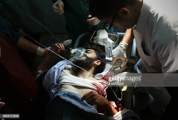 A wounded Pakistani student receives treatment at a hospital following an attack by Taliban gunmen on a school in Peshawar on December 16 2014...