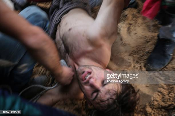 Wounded Palestinian Aed Abu Amro, who draw interest with his photograph captured by Turkey's Anadolu Agency's photojournalist Mustafa Hassona holding...