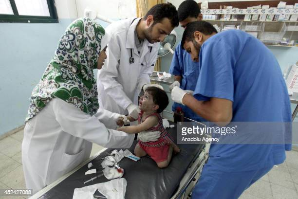 Wounded Palestinian are taken to the hospitals followed Israeli assaults, in Khan Yunis on July 20,2014. At least 60 Palestinians, including 17...