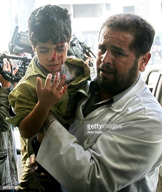 A wounded Palestinian boy is carried into the AlShifa hospital on December 28 2008 in Gaza City Gaza On the second day of crossborder conflict...