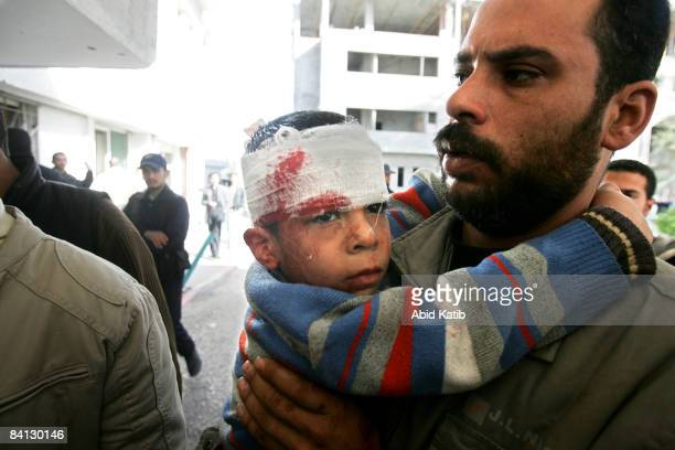 A wounded Palestinian boy is carried into to the AlShifa hospital on December 28 2008 in Gaza City Gaza On the second day of crossborder conflict...