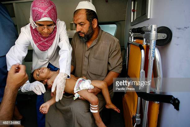 Wounded Palestinian child arrives at the hospital a after an Israeli air strike, in Rafah, in the Southern Gaza Strip. At least 10 people were killed...