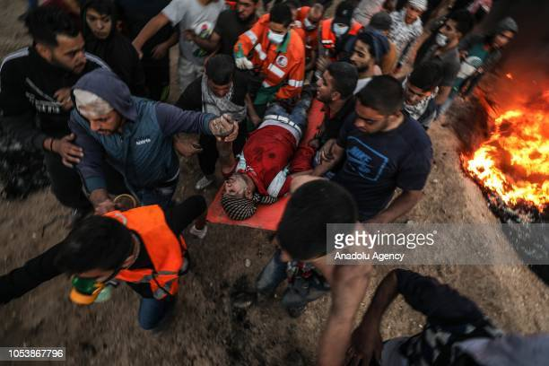 "Wounded Palestinian demonstrator is being taken away from the site after the intervention of Israeli forces during the ""Great March of Return""..."