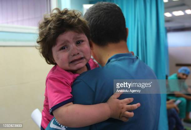 Wounded Palestinian girl is being brought to receive medical treatment at Al-Shifa Hospital after Israeli airstrikes hit various parts of Gaza Strip,...