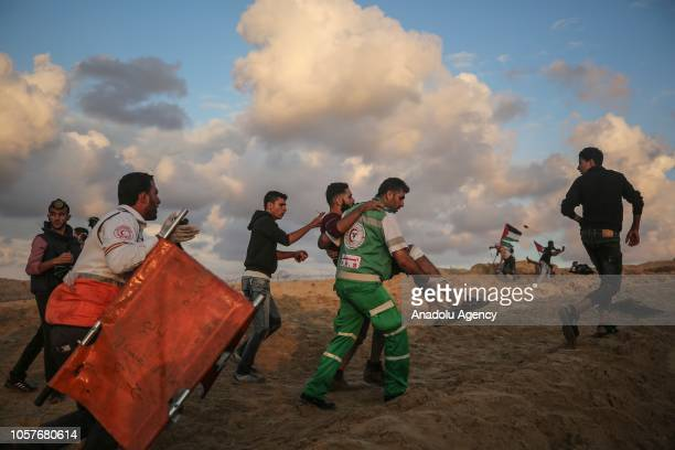 A wounded Palestinian is being carried away during the 15th 'maritime demonstration' to break the Gaza blockade by sea with vessel near the north...