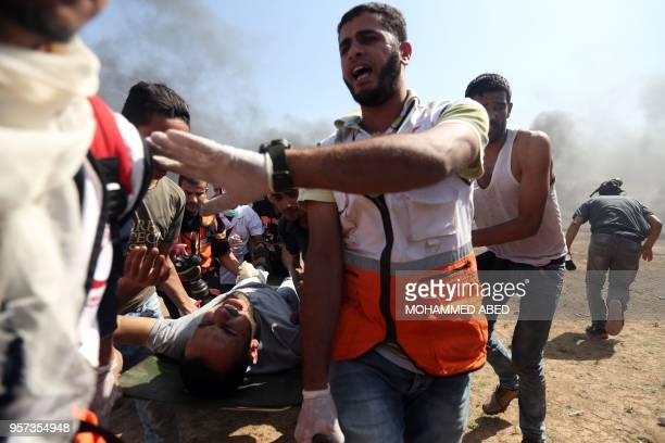 Wounded Palestinian is evacuated during clashes with Israeli forces along the border with the Gaza strip on the eastern outskirts of Jabalia on May...