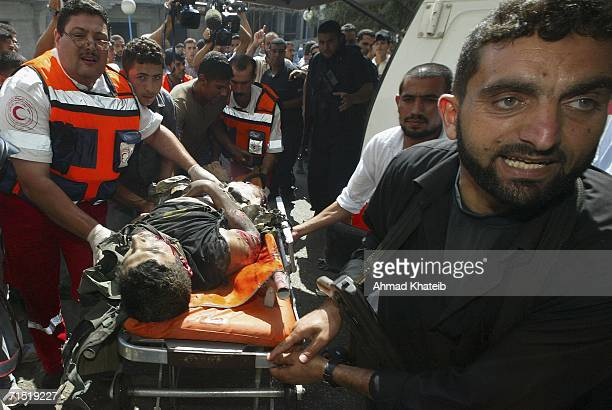 A wounded Palestinian is taken to the Shifa hospital after an Israeli airstrike July 26 2006 in Gaza City Gaza Strip Israeli aircraft fired missiles...