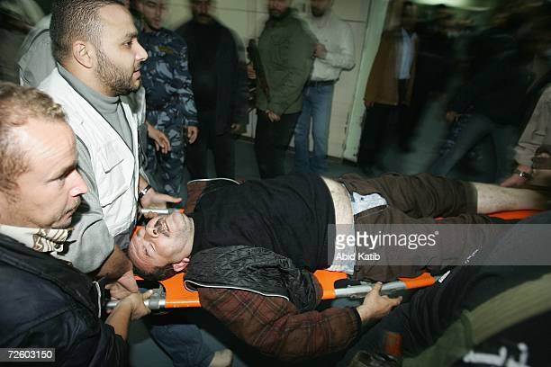 A wounded Palestinian man is wheeled into the AlShifa hospital after a car was targetted in an Israel Air Force strike on November 19 in Gaza City...