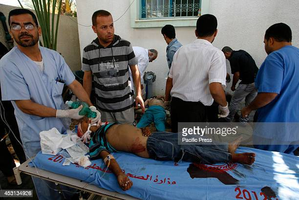 A wounded Palestinian man rushed to the hospital after an Israeli air strike in Rafah in the southern Gaza Strip At least 10 people were killed in a...