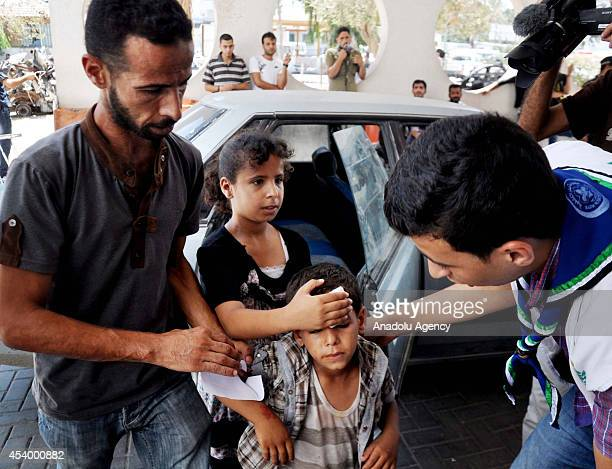 Wounded Palestinians are carried to AlShifa hospital after Israeli atatcks to Gaza on August 23 2014 Israeli army have hit 3 mosque and 30 targets...
