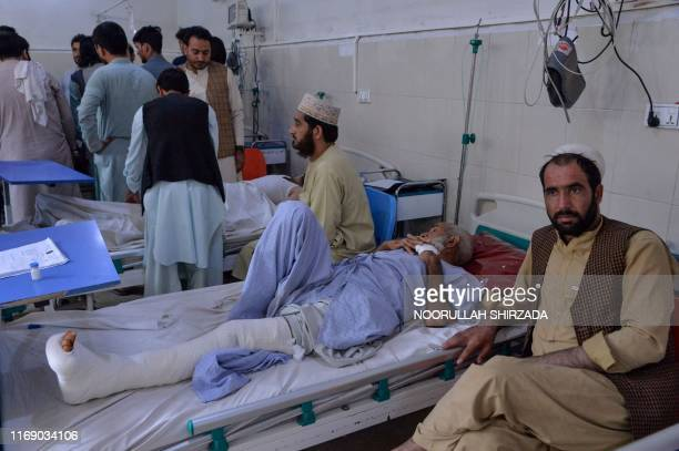 Wounded patients are being treated as they rest on beds at a hospital following a suicide attack in Jalalabad on September 18 2019 At least 12 people...