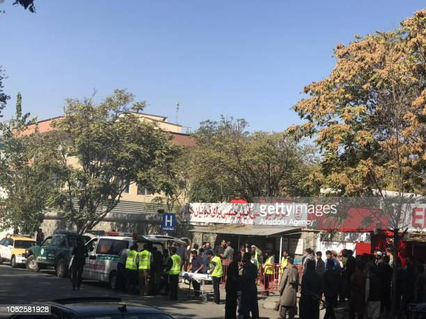 Wounded people are being carried to a hospital after a suicide attack targeted a polling station during the parliamentary elections in Wazir Akbar...