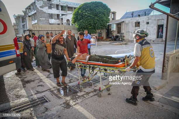 Wounded people are dispatched to hospital to receive medical treatment after Russian warplanes carried out airstrikes over villages of Idlib, Syria...