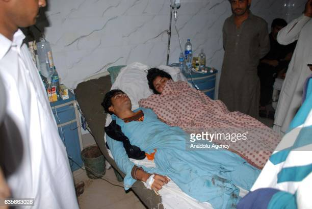 Wounded people receive medical treatment at a hospital following a suicide attack at the 13th century old shrine of a Muslim saint in the town of...