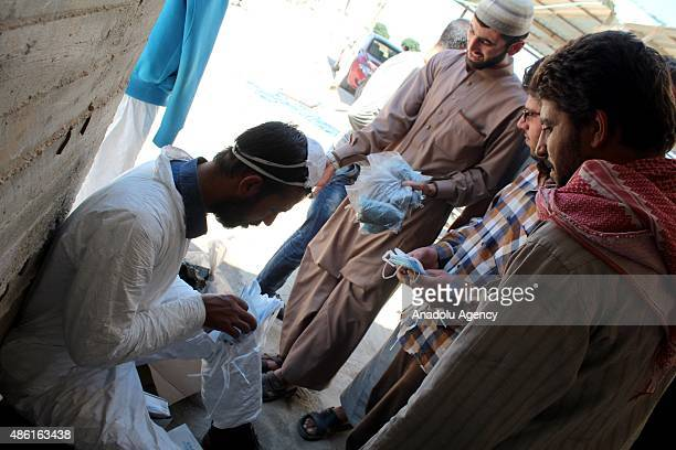 Wounded people receive treatment after Daesh terrorists' mustard gas attack in antiregimist forces controlled Mari District of Aleppo Syria on...