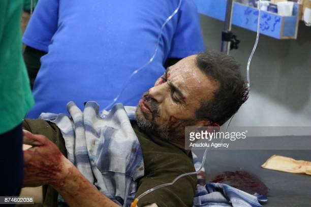 A wounded person gets treatment on the ground at a sahra hospital after Assad regime's warcrafts carried out an airstrike over residential areas of...