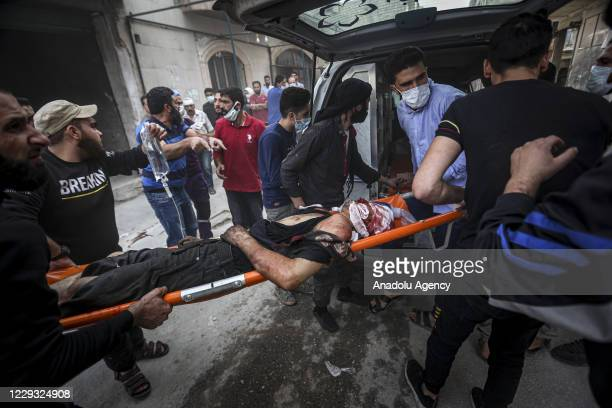 A wounded person is being taken to an ambulance after Assad Regime and Iran backed terrorist's artillery fire hits deescalation zone in Idlib Syria...
