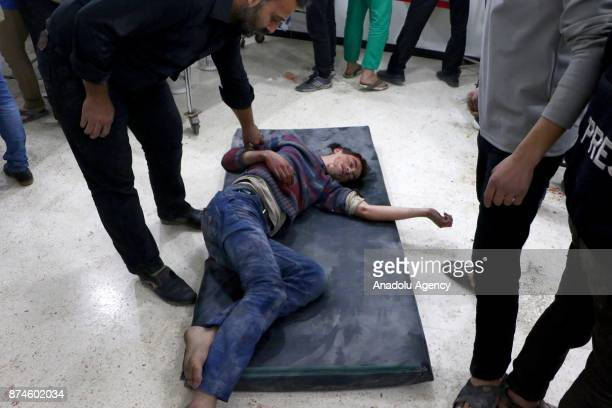 A wounded person waits for treatment on the ground at a sahra hospital after Assad regime's warcrafts carried out an airstrike over residential areas...