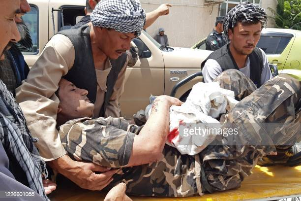 Wounded personnel of National Directorate of Security is brought on a stretcher to a hospital after a car bomb exploded in the city of Aybak, in...