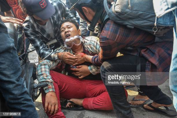 Wounded protester is seen after security forces intervene in protesters during a protest against military coup and detention of elected government...