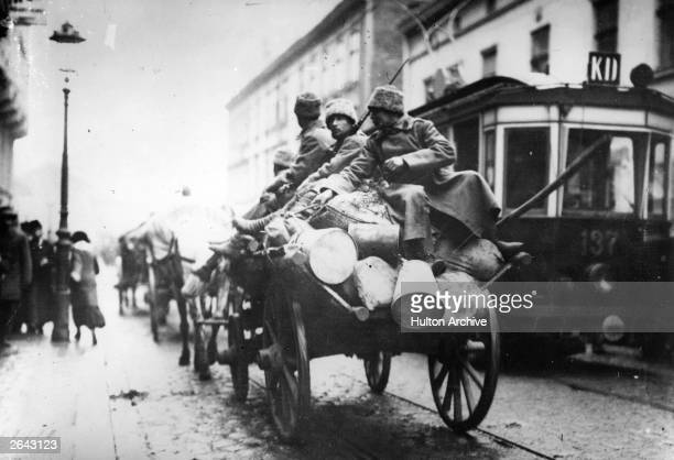 Wounded Russian soldiers arriving in Lemberg now Lvov on the back of a wagon