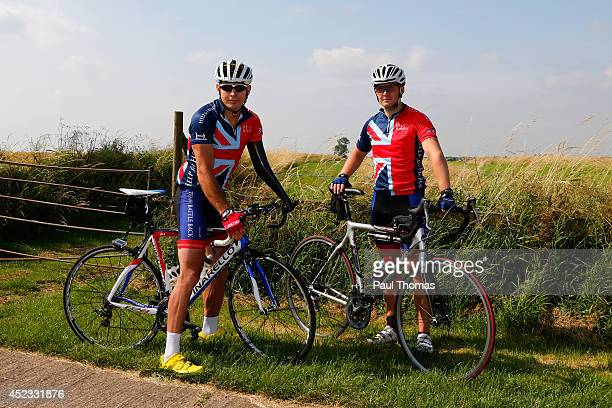 Wounded servicemen Jaco van Gass and Luke Darlington pose for a photograph during a training ride for the Invictus Games on July 18, 2014 in Gaydon,...