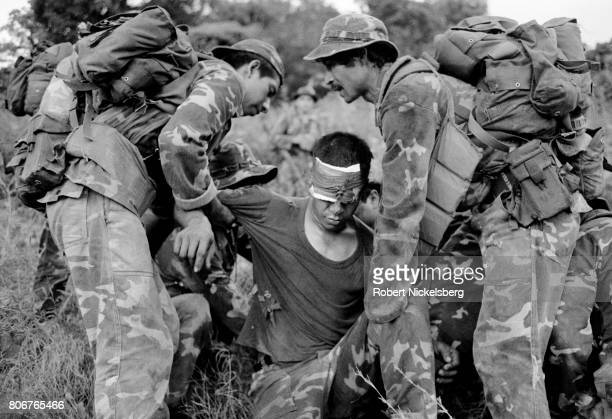 Wounded soldier from the Atlacatl Battalion is evacuated during a military operation pursuing guerrillas from the Farabundo Martí National Liberation...