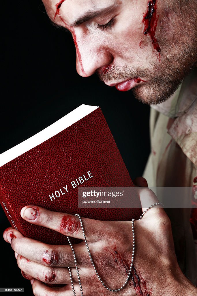 Wounded Soldier Holding Bible : Stock Photo