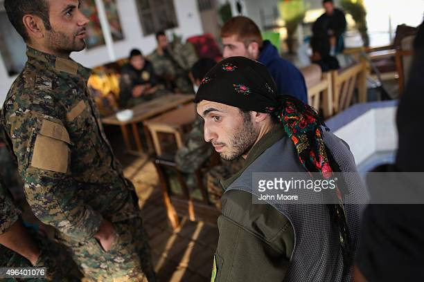 Wounded soldiers from the Peoples Protection Units spend time at a recovery center November 9 2015 in Hassika Rojava Syria They were wounded during a...