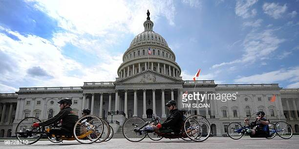 Wounded soliders from the Iraq and Afghanistan wars take part in the Wounded Warrior Soldier Ride on April 28, 2010 on Capitol Hill in Washington,...