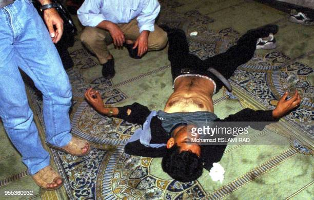 Wounded student inside the mosque of Tehran university .