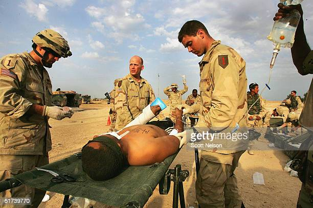 A wounded Sudanese Jihad fighter is treated by medics from the US Army 1st Infantry Division 22 Task Force on November 14 2004 in Fallujah Iraq The...