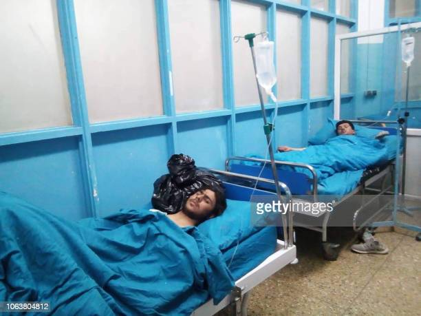 Wounded survivors receive treatment at Wazir Akbar Khan hospital in Kabul on November 20 following a blast at a meeting of top clerics in the Afghan...