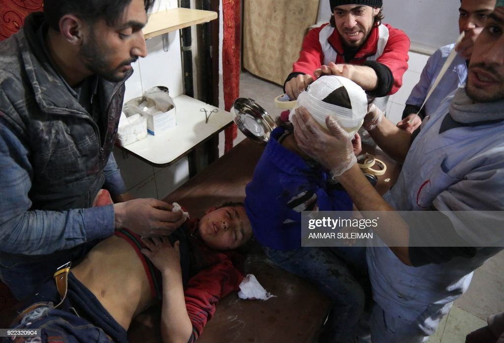 Wounded Syrian children receive treatment at a make-shift hospital in Kafr Batna following Syrian government bombardments on the besieged Eastern Ghouta region on the outskirts of the capital Damascus on February 21, 2018. Syrian jets carried out more deadly raids on Eastern Ghouta as Western powers and aid agencies voiced alarm over the mounting death toll and spiralling humanitarian catastrophe. PHOTO / Ammar SULEIMAN
