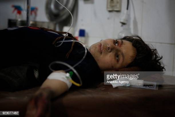 A wounded Syrian lies on a stretcher after Assad Regime's carried out airstrikes and artillery fires at Kafar Batna of Eastern Ghouta deescalation...