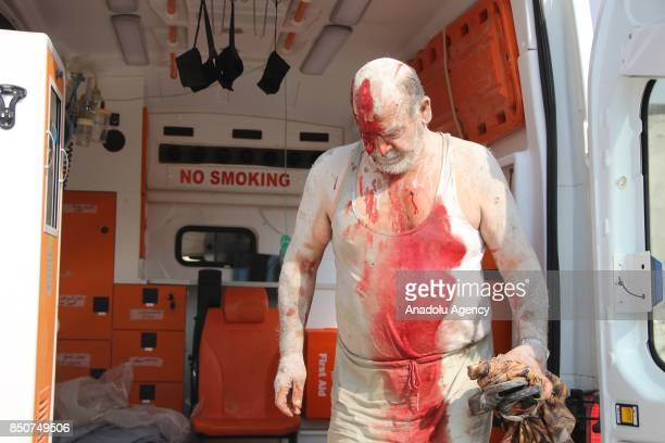 A wounded Syrian man is seen into an ambulance as he is taken to Sahra hospital after airstrikes hit Khan Sheikhun town of Idlib Syria on September...
